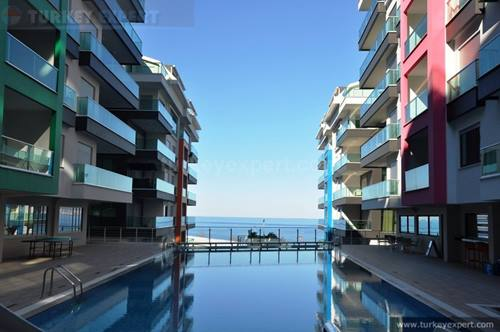 Sea front apartment for sale in Konak Seaside Resort,  with a booking.com rating of 9.9 (Price reduced)