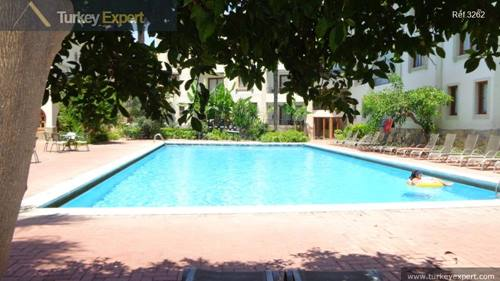 Furnished apartment with pool, high rental potential, right in the town center of Kusadasi