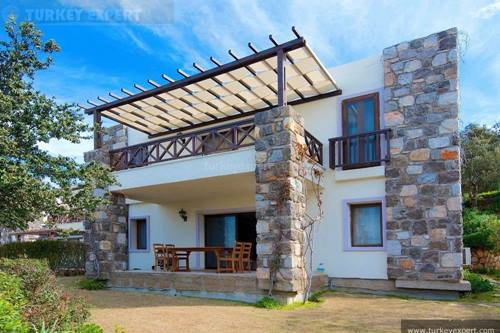 Detached holiday home for sale in Bodrum Gumusluk with beautiful sea and sunset views