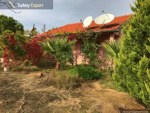 Farm house with a separate guest house on a 11000 m2 land for sale in Kusadasi, good potential