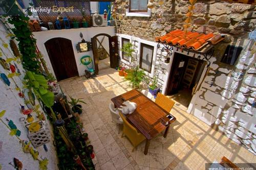 Traditional stone house for sale with yard and sea view in Bodrum center